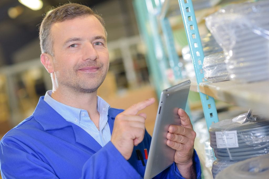 worker using a tablet to store information